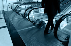 Man going down the escalator Stock Images