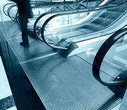 Man going down the escalator Stock Image