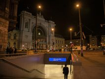 Man going down the stairs of a metro Station in front of Budapest Keleti Palyaudvar train station at night. Picture of people going down the stairs of a metro royalty free stock images
