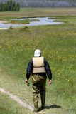 Man going fishing. Man wearing waders in yellowstone national park, heading out for some fly-fishing Stock Photography