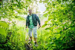 Man going through forest Stock Photo