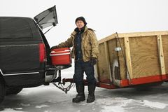 Man going ice fishing. Stock Images