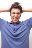 Man going mad. A man with funny angry expression Stock Photography