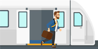 Man going out of train Royalty Free Stock Photo