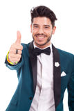 Man going thumb up, focus on hand Royalty Free Stock Image