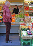 Man is going to buy something in vegetable store Stock Images