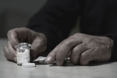 Man going to overdose drugs Royalty Free Stock Photography