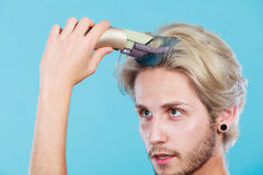 Man going to shave his long hair Stock Photography