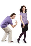 Man going to smack with fingers on back of woman Stock Images