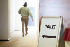Free Man Going To Toilet Stock Photo - 50735890