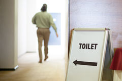Man going to toilet Stock Photo