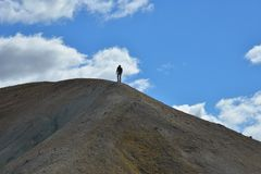 Man going to top of hill Royalty Free Stock Images