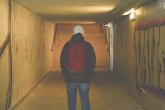 Man going in underpass. Graffiti in subway. Man going in underpass. Graffiti in subway Stock Photography