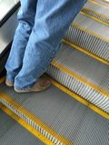 Man going up escalator Royalty Free Stock Photography