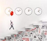 Man going upstairs, time running Stock Photo