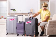 The man going on vacation with fragile suitcases royalty free stock images