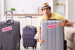 The man going on vacation with fragile suitcases royalty free stock photography