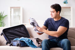 The man going on vacation packing his suitcase Royalty Free Stock Images