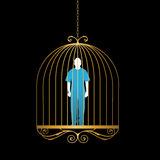 Man in gold bird cage Royalty Free Stock Photo