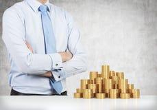 Man and gold coins Stock Photos