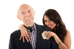 Man with gold-digger companion or wife stock image