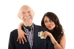 Man with gold-digger companion or wife stock photos