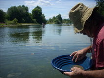 Man gold panning Royalty Free Stock Images