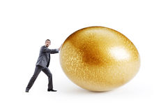 Man and golden egg Royalty Free Stock Image