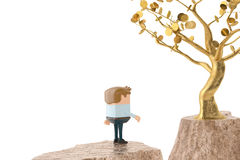 A man and a golden tree on both sides of the cliff.3D illustrati Royalty Free Stock Photo
