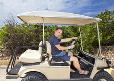 Man by golf car on the seashore. Mexico Royalty Free Stock Photography