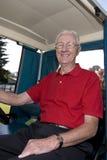 Man in Golf Cart Smiling Royalty Free Stock Photo
