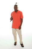 Man WIth Golf Club. Casual young African American man in a bright orange golf shirt holding a golf club Stock Photo