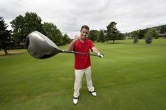 Man with Golf Club - Horizontal Stock Photo
