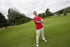 Man with Golf Club - Horizontal Stock Photography
