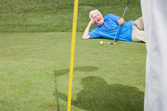 Man on a golf course Royalty Free Stock Photography