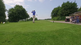 Man at golf course doing a drive stock video