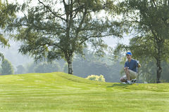 Man on Golf Course Playing Golf - Horizontal Stock Photos