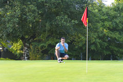 Man on Golf Course Playing Golf - Horizontal Royalty Free Stock Photography