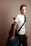 Man with golf set. Wearing golfing clothes royalty free stock images