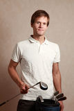 Man with golf set Stock Photography