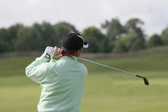 Man golf swing at practice Stock Photo