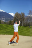 Man golfer at the bunker on a golf course Royalty Free Stock Images