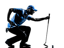 Man golfer golfing crouching silhouette. One man golfer golfing crouching in silhouette studio isolated on white background Stock Photo