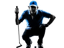 Man golfer golfing crouching silhouette Stock Images