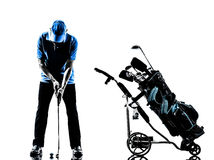 Man golfer golfing golf bag  silhouette. One man golfer golfing golf bag   in silhouette studio isolated on white background Royalty Free Stock Image