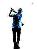 Man golfer golfing golf swing  silhouette. One man golfer golfing golf swing in silhouette studio isolated on white background Royalty Free Stock Photography