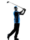 Man golfer golfing silhouette. One man golfer golfing in silhouette studio isolated on white background royalty free stock photos