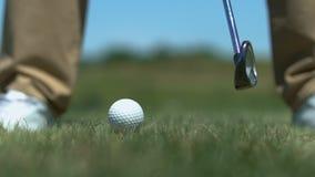 Man golfer hitting ball with iron club on short distance to avoid hazard closeup. Stock footage stock video