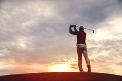 Man golfer silhouette. Silhouette of man golfer with golf club at sunset. back view Stock Photos