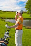 Man golfer watching into rangefinder Stock Image